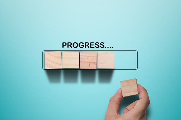 hand-putting-wooden-cube-virtual-infographic-rectangle-block-with-progress-wording-job-progressive-concept